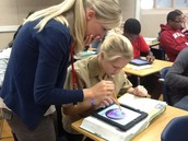 Ms. Johnson's class using iPads
