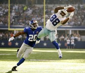 This is Dez catching a football in a game against the NY Giants