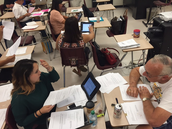 Teachers compare student work to anchor papers