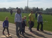 Mrs. Murphy and Mrs. Cunningham walk laps with students on Lap Day