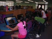 Students research using the AISD databases.