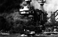 'A U.S. battleship being destroyed by the Japanese planes and submarines'.