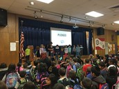 Ms. Bennett's awesome kinder Panthers lead us in the pledges at assembly!