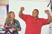 """Mrs. Redmon receives """"Stars in the Classroom Award"""" from Chris Polk of the Houston Texans"""