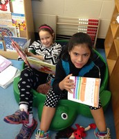 Mia and Abigail searching for sight words in familiar books