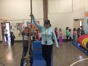 Mrs. Porter teaching our students about the obstacle course.