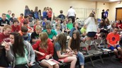 8th graders learning about AHS activities