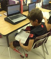 Students in Mrs. Reid's 6th Grade ELA Class work on a NearPod formative assessment over citing evidence.