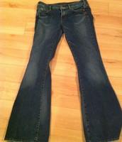 84. Silver Jeans, Size 28, Wear on back of heels