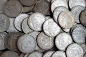 How Much Silver is in a Silver Dollar- Determine the Value of Your Coins