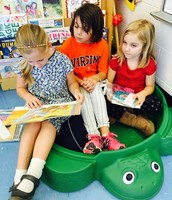 Beatrice and Shayna reading with a fourth grade buddy in Mr. Turtle