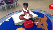 Sumayyah reading to self during Daily 5
