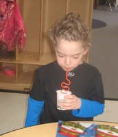 .Drinking water through a Krazy Straw during snack!