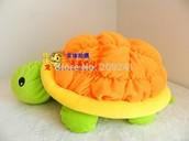 La toruga de peluche naranja