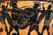 This is a picture of Spartan children being taught to fight.