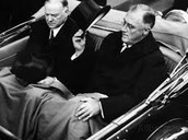 Herbert Hoover riding with FDR