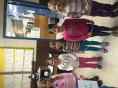 """We are readers! Kindergarteners showcasing their new reading strategy """"Eagle Eye"""""""
