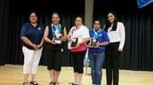 Parent Volunteer receive an award for highest volunteer hours, second semenster!