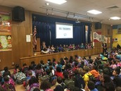 Ms. Bennett's kinder Panthers lead the school in mindful listening at SEL Assembly!