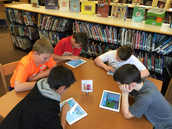 Fourth graders doing Hour of Code on the iPads!