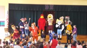 Mascots interact with the children