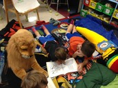 Marcus, Daire, a Lion, and a Banana during Readers Retreat