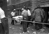 Volunteers carrying out a body