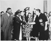 Bethune shaking hands with E. Roosevelt