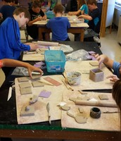 5th graders working on clay