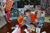 Little boy with alot of presents