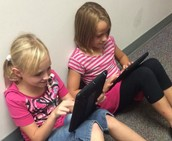Second Graders enjoy working on the iPads