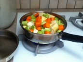 Cooking the vegetables using the sauce from the meat