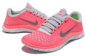 Pink and white Nike shoes- Hana Tate