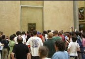 A crowd gathers around the Mona Lisa