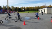 Children enjoying riding bikes on a sunny day