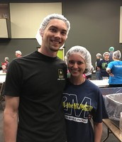 Maggie and Patrick packing meals for 3rd world countries at Feed the Hunger, Rockpointe Church
