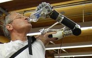 A man using his robotic arm