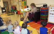 "Ms. Rhonda reading ""The Very Quiet Cricket"""