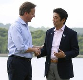 Prime Minister of Japan Shinzo Abe shakes hands with Prime Minister of the United Kingdom David Cameron