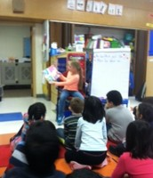 Our very own Diana reads to the Class!