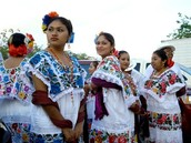 Who wears a Huipil?