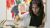 With a new arm, a young war victim finds her artistic talent
