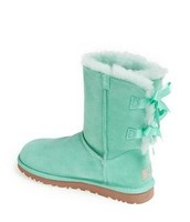 Blue uggs with blue bows in the back