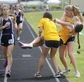 Teammates helping Kayla