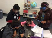 6th Grade students use iPads to record weathering and erosion experiments.