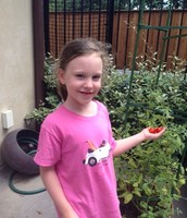 Gracie with her tomatoes