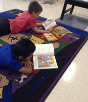 Reading together on the carpet
