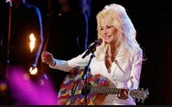 This is Dolly playing her sparkly guitar