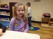 Emma made a pink, blue , yellow star pattern