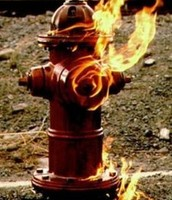 A fire hydrant on fire.